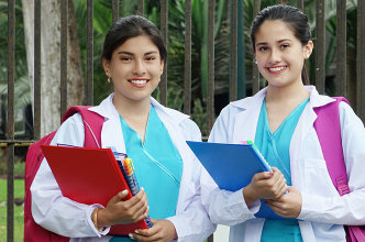 two young adult female holding documents